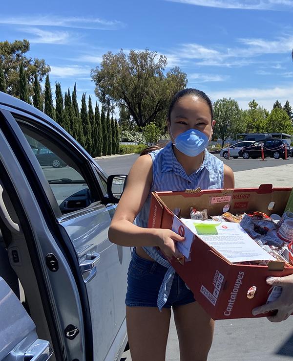 Jacqueline delivering food