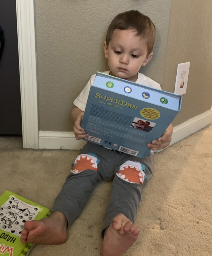 Jens son reading food allergy book